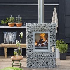 love this narrow, modern outdoor fireplace! Home Garden Plants, Home And Garden, Gabion Wall Design, Modern Outdoor Fireplace, Outdoor Bbq Kitchen, Garden Design Plans, Garden Deco, Garden Living, Garden Fencing