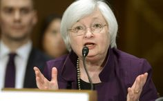 Fed takes tough stance on bond liquidity, downplays market fears