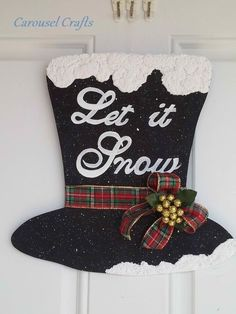 For holiday sales. Snowman Hat Let It Snow Hanging Craft. By Carousel Crafts Noel Christmas, Christmas Signs, All Things Christmas, Winter Christmas, Christmas Wreaths, Christmas Decorations, Christmas Ornaments, Christmas Door Hangings, Black Christmas