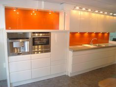 ColourX Orange backpainted glass kitchen splash back Modern Kitchen Cabinets, Glass Kitchen, Kitchen Tiles, Kitchen Interior, New Kitchen, Orange Kitchen Decor, White Gloss Kitchen, Kitchen Colors, Back Painted Glass