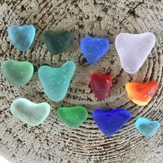 Genuine surf tumbled Sea glass small & mini heart shaped. Great for beach wedding decor. Collected from Multiple places, California, Hawaii, Puerto Rico & hawaii.