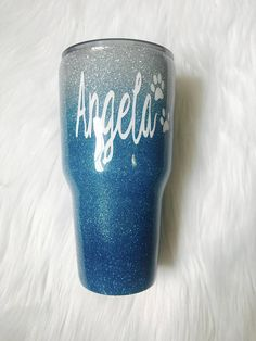 Light blue ombre glitter dipped insulated tumbler. Decorated with real high quality glitter. Glittered by hand so your cup will be one of a kind. 20oz/30oz OZARK/Rtic tumbler. Carefully sealed with FDA approved formula for a safe, smooth and, sparkly finish. Included We can add a monogram, name, quote or design which will be sealed so it will not come off your cup and you will not be able to feel it! just message us what you would like. No shedding, smooth texture, still all the sp...