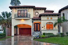 Good way to expand a typical Tract House.  Build over garage for new MBR, convert old garage into living space.  In this case I would have turned the car portico into a full garage.  Add decorative trim and you have a  fabulous looking re-model.