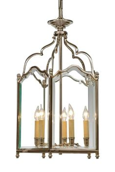 Cast brass and beveled glass English style five light lantern. Shown in custom polished nickel finish.