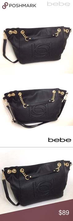 """Bebe Tote in Black/Gold-Offers Welcome🌷 Brand new with tags. Bebe Lara Shopper in Black. So chic! Crafted from high quality faux leather, this roomy tote by Bebe is the perfect carry all for the shopper on the go. Features raised Bebe logo on the front; gold tone hardware; top magnetic snap closure; outer zipper pocket on the back wall; 2 slip and 1 zip pocket on the inside; fully lined. Comes with a detachable shoulder strap. Measures approx. 18""""W X 11""""H X 6""""D. bebe Bags Totes"""