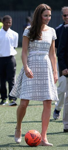 dribbling a 'football' wearing her pied-a-terre wedged espadrilles...my kind of girl!