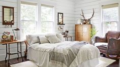 """<p>You don't need to buy brand-new stuff to make your bedroom a cozier spot to lounge—shiplap walls, antique blankets, and an old leather chair from Craigslist help make<a rel=""""nofollow"""" href=""""http://www.countryliving.com/home-design/house-tours/g3689/lindsea-dragomir-washington-farmhouse/?slide=8&thumbnails="""">this antique dealer's bedroom</a>a restful and calm respite.</p>"""