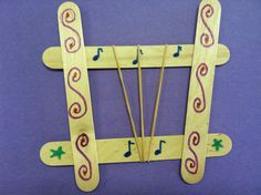 """Harp craft. Jumbo Popsicle sticks + wood glue. Assemble ahead and let dry completely. Let children decorate with markers and add rubber band """"strings."""" #preschool #harp #craft #king #David"""