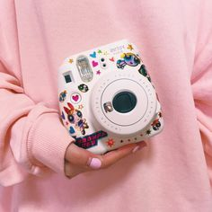 Sticker decorated Instax mini camera.