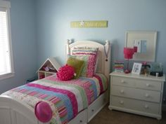 Soothing blue, use bedding and accents to bring in pink