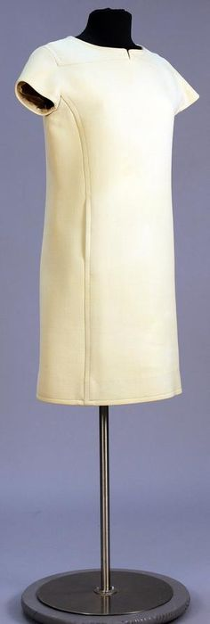 Day dress in shift style of off-white wool knit. Knee length