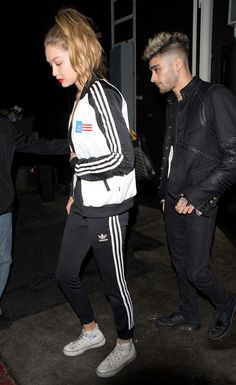 Gigi Hadid in an Adidas Tracksuit and Converse All Stars.