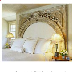 what a great idea for a headboard. using an old mantle piece.