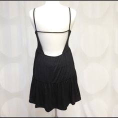 Deep open back dress Another inspiration by Brandy Melville. Flawy casual dress, wear it with cage Brallette. Loose fit. Made in USA. 95% rayon, 5% spandex. This listing is for M. There are another listing for S and L. Price is FIRM unless bundled April Spirit Dresses Mini