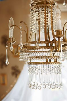 Add some glimmer with our Hayleigh Gold Chandelier
