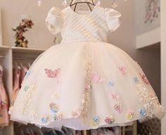 No photo description available. Baby Girl Birthday Dress, 1st Birthday Party For Girls, Baby Girl Party Dresses, Birthday Dresses, Little Girl Dresses, Princess Flower Girl Dresses, Baby Frocks Designs, Baby Dress Patterns, Butterfly Birthday