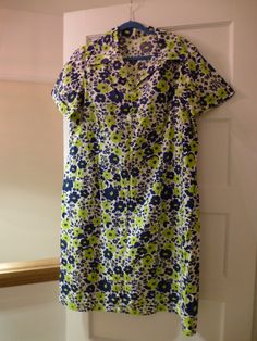 Description:1970s handmade dress with dark blue and vibrant lime green floral print. Feels like a good quality think cotton. Large collars and 3 little decorative fabric covered buttons at bottom of collar.No LabelMeasurements (measure laid flat):across chest 24  inches / 61.5 cmsacross waist 23 inches /  59 cmsshoulder to hem 42 inches / 107 cmsPostage/Packaging:We will try to use recycled packaging or the most cost effective packaging. If you would like t...