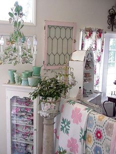 Love those quilts and the pink frame on the window (from ShabbytownUSA Home Page)