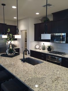 K Hovnanian homes. Amazing kitchen. Clear white tiles for backsplash.