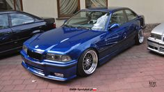 Avus blue BMW e36 coupe on custom 18'' 3 piece wheels from OEM BMW Styling 29 (BBS RC041) wheels