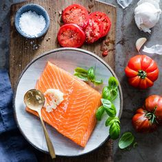 This recipe is so beautiful and yet so simple to prepare--it& perfect for entertaining. You just spread a side of salmon with minced garlic, sprinkle with fresh basil, then layer sliced tomatoes on top. Put it on the grill for 10 minutes and you& done! Basil Recipes, Salmon Recipes, Fish Recipes, Seafood Recipes, Salmon Meals, Tilapia Recipes, Orange Recipes, Seafood Dishes, Grilling