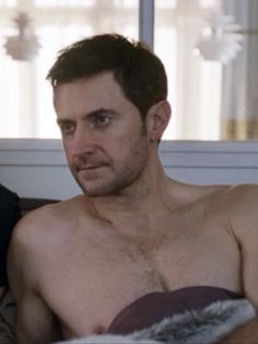 Daniel watching tv with Esther from the bed (wow chest hair!)