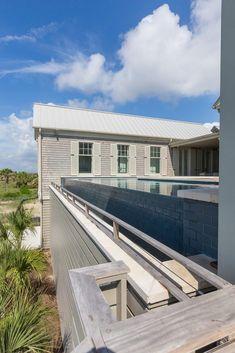 Infinity pool with Baja Ledge. Swimming Pool Designs, Swimming Pools, Isle Of Palms, Blue Pool, Hot And Humid, Luxury Pools, Pool Builders, Spa Services, Aqua Blue