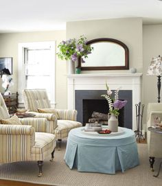 A mahogany mirror that dates from 1910 hangs above the mantel in this Maine country cottage.