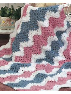 """Baby's Quick Ripple Crochet Afghan Pattern Welcome Baby with this quick-to-stitch ripple crochet afghan. This easy-to-follow crochet afghan pattern is worked with 2-ply mohair-look yarn using a size K/10 1/2 crochet hook. Finished size is approx 32 x 36"""". Designed by Melissa Leapman free pdf pattern from free-crochet.com"""