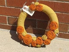 How to make an adorable rosette wreath! Just adjust colors for season.