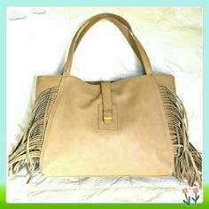 """💖🎉 HP 💚💚 Hugo fringe bag in light brown, taupe 🌟This tote features magnetic snap clouser inside, decorative, non functional pull through clouser, fringe detailing, and two inside pockets.   🌟Details: L 16"""", H 12"""", D 3-1/2"""", faux leather. The color is beige taupe, light brown, not yellowish. I found it difficult to take the right picture.  🌟Please use only ✔OFFER 👈 button for all price negotiations. I'll do 👉🍓a price drop⤵ for you for discounted shipping, if we agree about the…"""