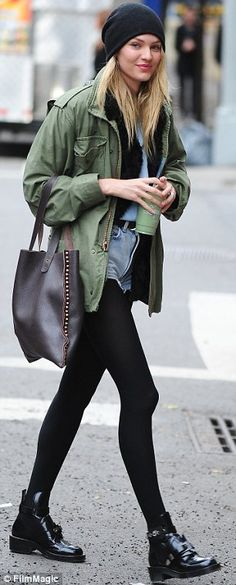 Candice Swanepoel.. sheer stockings + khaki jacket + denim tear-away shorts.. booties.. city chic..
