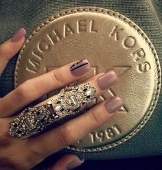 amazing ring. This is a copy of a Loree Rodkin armor knuckle ring. I LOVE her jewelry.