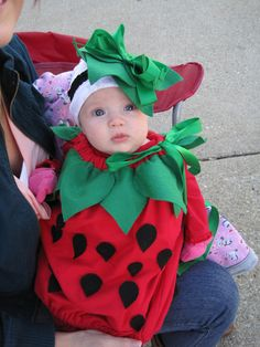 Homemade infant strawberry costume.
