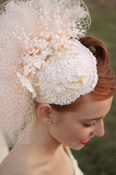 Delightful little hat - lace, ruffles of net and tulle, flowers and pearls in delicate peachy pinks and cream.