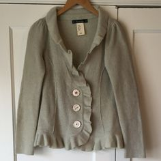 Cartonnier Anthropologie Ruffle Boiled Wool Jacket Jacket/sweater, 100% boiled wool. Light whisper sea green with vintage-style buttons with orange stitching. Slight puff shoulder. Ruffles at collar, button placket and hem. Feminine fit. Great condition; a few small marks/dirt stains at top and bottom of ruffle placket- these aren't too noticeable and should come out. No trades, no PP. Anthropologie Jackets & Coats