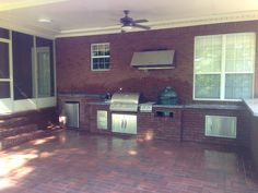 This Outdoor Kitchen Has It All  Green Egg Gas Grill Refrigerator Side Burners Storage concrete countertops even a Hood Vent with Lights