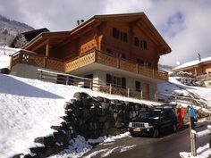 Chalet Logo with private parking space for 3 cars in front.