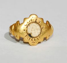 Tudor Mori Ring-Excerpt: Circa 1580,a hexagonal scalloped bezel set with a white enamel skull and surrounded by the Latin motto : 'Coglia Mori' - 'plucked by death'. Such rings were a timely reminder of the importance of preparation for death and one is listed in Henry VIII's inventory : A ringe of gold with a deathes hedde'.