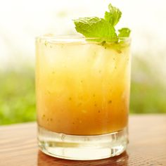 Half a lemon - Half a peach, pitted - 6 to 8 Fresh mint leaves - 1 tsp Sugar cane syrup - 2 oz Bulleit Bourbon - .75 oz Cointreau. In a shaker, muddle the lemon, peach, mint and sugar cane syrup. Add the bourbon and Cointreau, and fill with ice. Shake, and strain into an Old Fashioned glass filled with crushed ice. Garnish with a sprig of fresh mint.