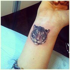 Small tiger wrist tattoo