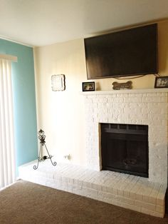 Mounted TV over white fireplace.