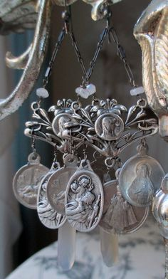 'silver medals' vintage assemblage earrings with Catholic charms by The French Circus on Etsy
