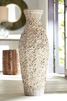 We like it filled with some feathery grass or light-toned blooms, and we love the look of two framing a favorite table or doorway. Either way, Pier 1's handcrafted Woven Natural Floor Vase brings natural elements and artisanal style to your favorite corner or nook.