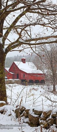 A Red New England Barn in the snow.
