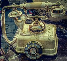 Picture of Old telephone sitting on a table with old things. Image digitally manipulated in the form of old photos. stock photo, images and stock photography. Telephone, Landline Phone, Old Photos, A Table, Old Things, Stock Photos, Digital, Image, Photography