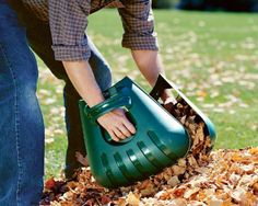 """Leaf Scoops. Gather raked leaves in half the time with these extra large """"hand extenders"""". Molded from lightweight, high quality polypropylene, they fit any size hand comfortably, letting you quickly pick up grass clippings, leaves and piles of weeds. A safe way to feed leaf shredders, too."""