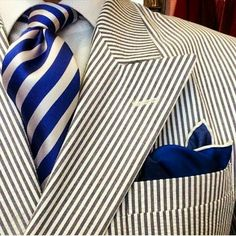 This is pretty much DSP (Dead Solid Perfect) classic southern dressing: silk repp tie, seersucker DB suit, white shirt, navy blue pock square. You are officially ready for a great summer event. Have a great time.
