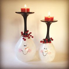These two happy snowman faces will bring visual warmth to any table or mantle. They are inverted wine glasses double painted by hand and baked for