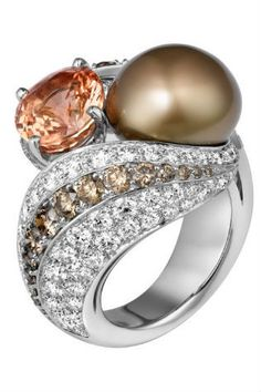 Cartier Platinum Ring set with a padparadscha sapphire, a pearl and diamonds. gallery - Vogue Australia